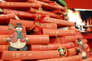 christmas tree made of books with ornaments