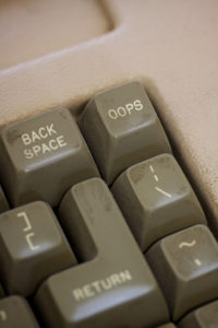 old word processing keyboard with Ooops button. writing mistakes